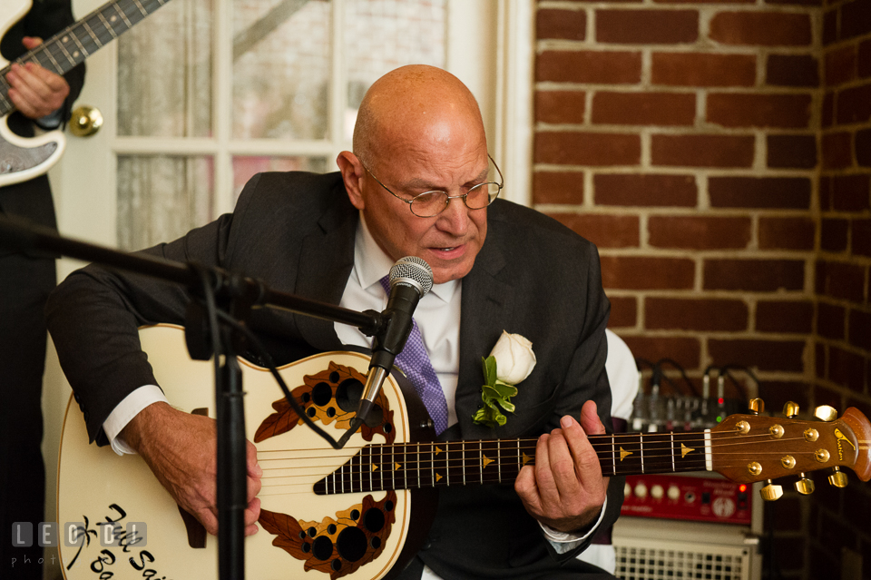 Father of the Bride singing and playing guitar for the newlyweds. Historic Inns of Annapolis Maryland, Governor Calvert House Greek wedding, by wedding photographers of Leo Dj Photography. http://leodjphoto.com