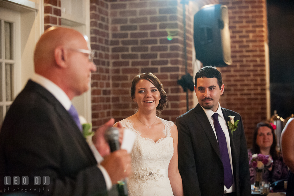 Bride and Groom listening to Father of the Bride giving speech. Historic Inns of Annapolis Maryland, Governor Calvert House Greek wedding, by wedding photographers of Leo Dj Photography. http://leodjphoto.com
