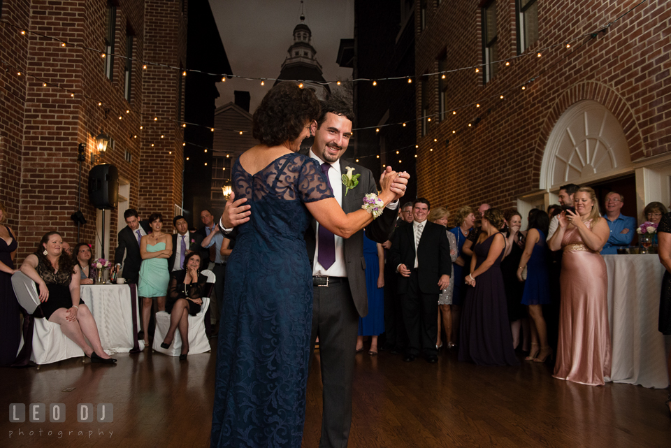 Mother of the Groom dances with her son. Historic Inns of Annapolis Maryland, Governor Calvert House Greek wedding, by wedding photographers of Leo Dj Photography. http://leodjphoto.com