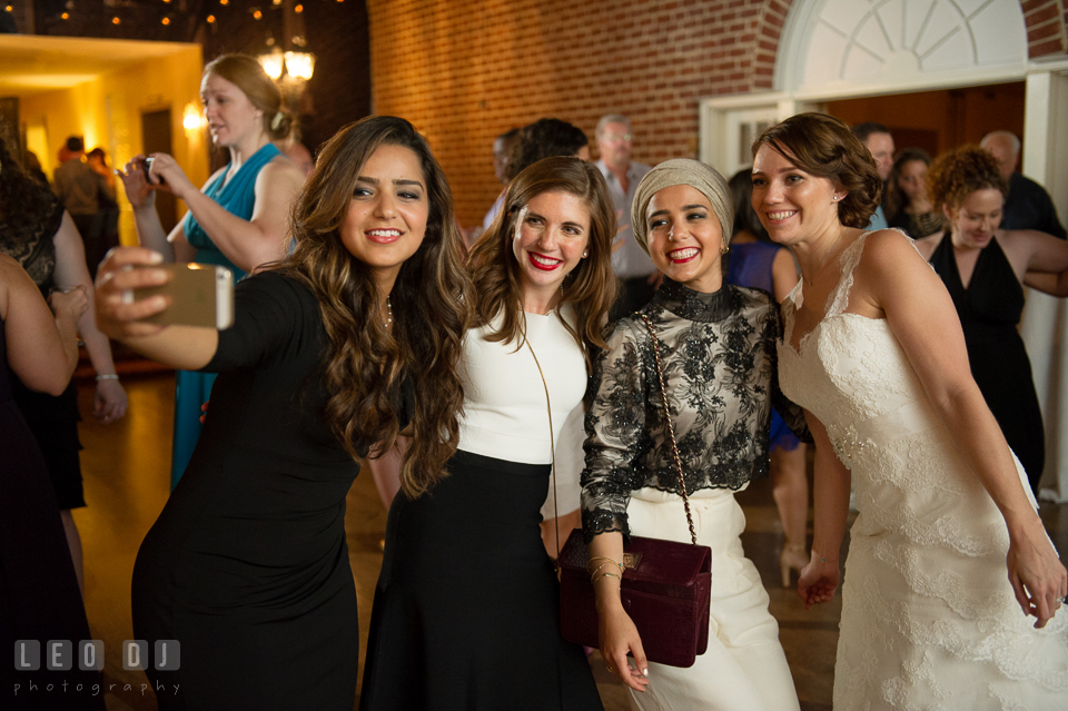 Guests and Bride taking selfie picture at wedding reception. Historic Inns of Annapolis Maryland, Governor Calvert House Greek wedding, by wedding photographers of Leo Dj Photography. http://leodjphoto.com