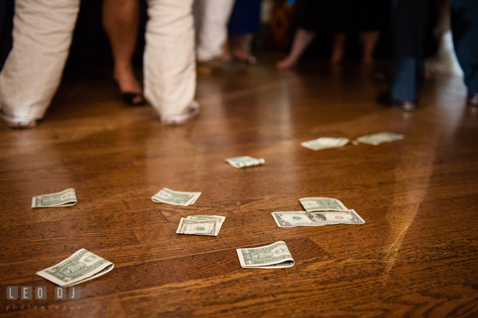 Dollar bills on the floor on wedding reception tossed by the Father of the Groom during the Greek dance. Historic Inns of Annapolis Maryland, Governor Calvert House Greek wedding, by wedding photographers of Leo Dj Photography. http://leodjphoto.com