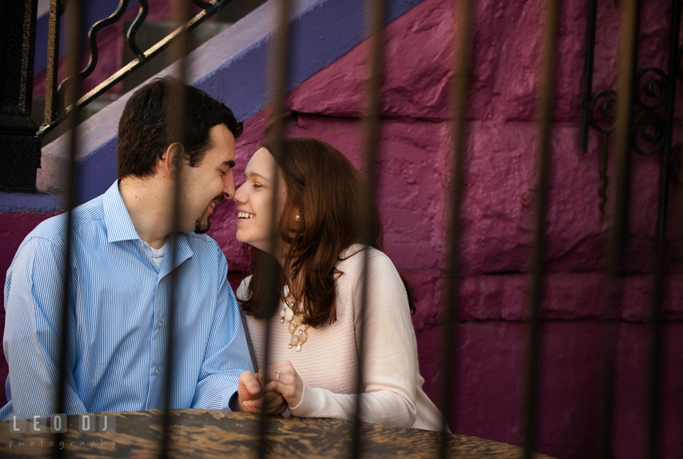 Engaged couple sitting together laughing. Washington DC pre-wedding engagement photo session at Adams Morgan and the Smithsonians, by wedding photographers of Leo Dj Photography. http://leodjphoto.com