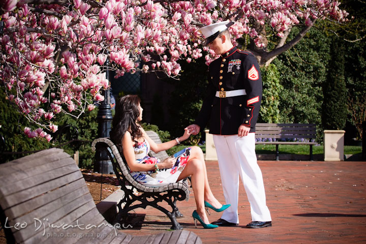Engaged Marine officer in military uniform holding his fiancée's hand. Pre wedding engagement photo Washington DC Smithsonians museum and Ronald Reagan Washington National Airport DCA, by wedding photographer Leo Dj Photography