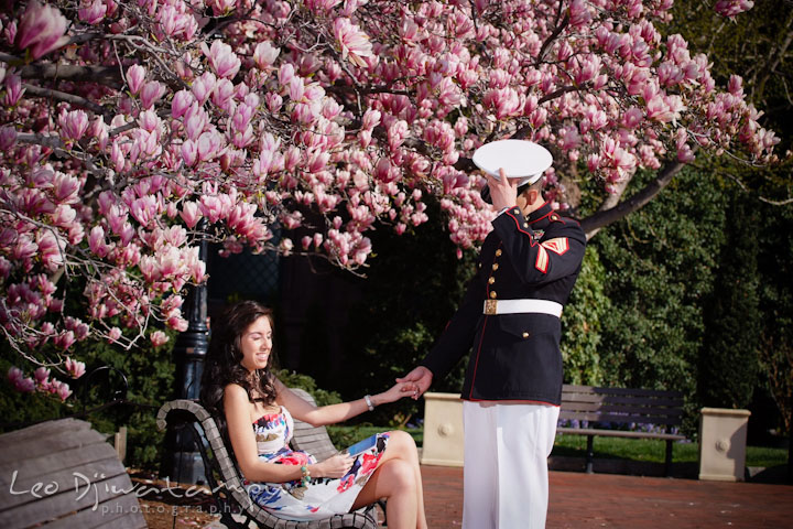 Engaged Marine officer in military uniform holding his fiancée and took off hat. Pre wedding engagement photo Washington DC Smithsonians museum and Ronald Reagan Washington National Airport DCA, by wedding photographer Leo Dj Photography