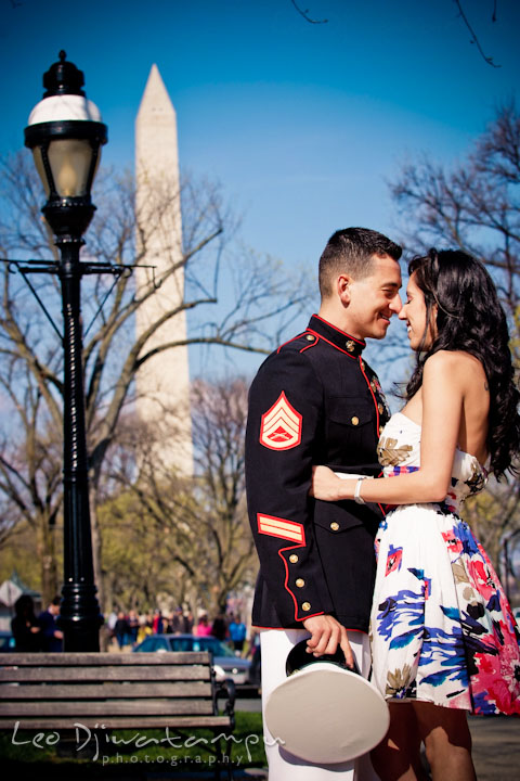 Engaged girl cuddled with her fiancé, a Marine officer in military uniform. Washington Monument in the background. Pre wedding engagement photo Washington DC Smithsonians museum and Ronald Reagan Washington National Airport DCA, by wedding photographer Leo Dj Photography