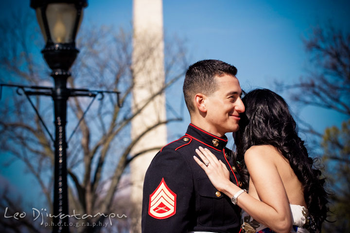 Engaged girl hugging her fiancé, a Marine officer in military uniform. Washington Monument in the background. Pre wedding engagement photo Washington DC Smithsonians museum and Ronald Reagan Washington National Airport DCA, by wedding photographer Leo Dj Photography