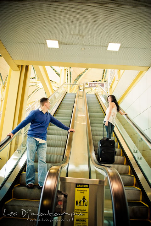 Engaged guy and girl looking at each other as they passed at the escalator. Pre wedding engagement photo Washington DC Smithsonians museum and Ronald Reagan Washington National Airport DCA, by wedding photographer Leo Dj Photography