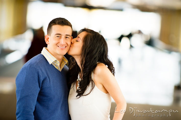 Engaged girl kissed her fiancé's cheek. Pre wedding engagement photo Washington DC Smithsonians museum and Ronald Reagan Washington National Airport DCA, by wedding photographer Leo Dj Photography