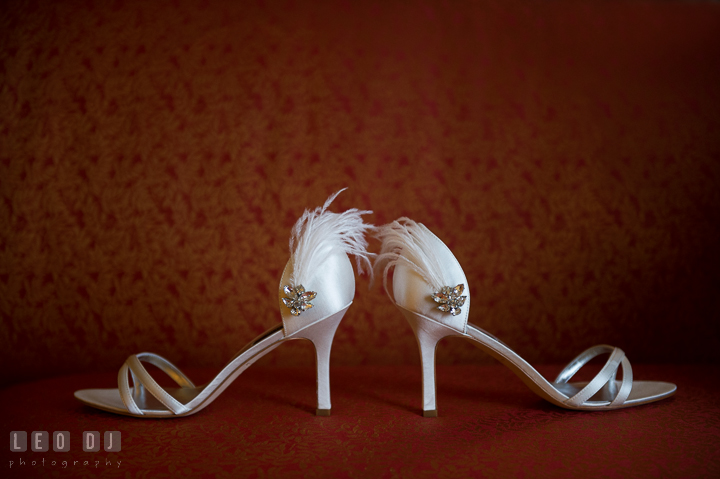 Bride's wedding shoes with feather and jewelry. Marriott Washingtonian Center wedding at Gaithersburg Maryland, by wedding photographers of Leo Dj Photography. http://leodjphoto.com