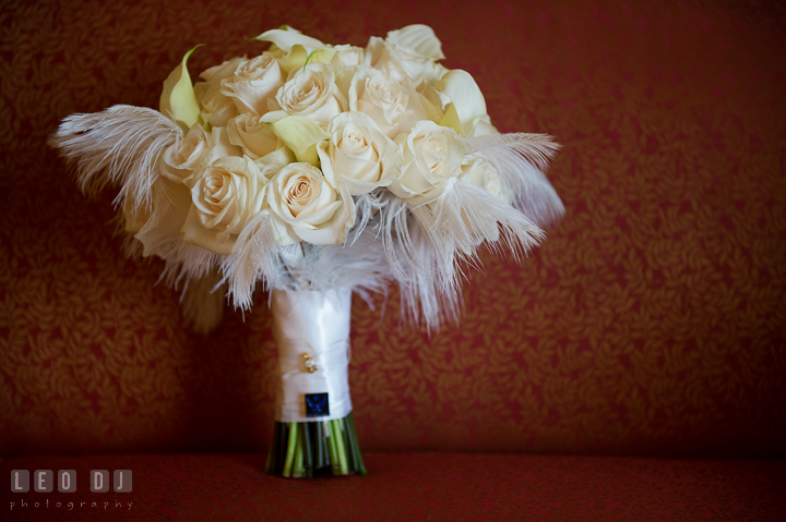 Bride's white rose and lily flower bouquet with feathers by Sweet Blossoms. Marriott Washingtonian Center wedding at Gaithersburg Maryland, by wedding photographers of Leo Dj Photography. http://leodjphoto.com