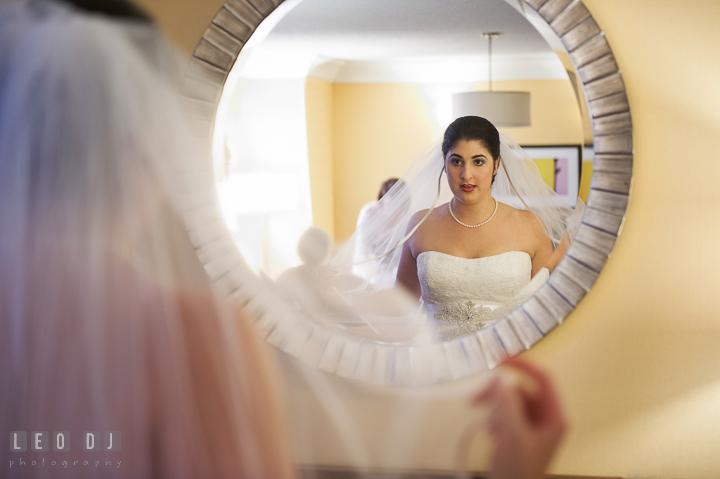 Bride looking at mirror, fluffing her veil. Marriott Washingtonian Center wedding at Gaithersburg Maryland, by wedding photographers of Leo Dj Photography. http://leodjphoto.com