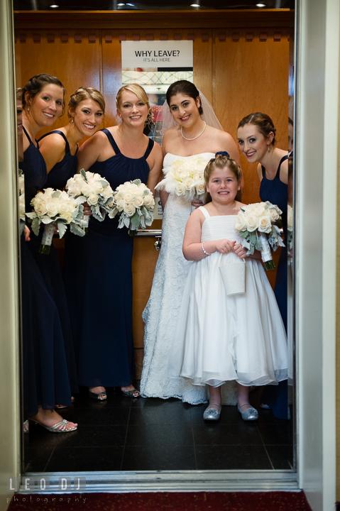 Bride, maid of honor, bridesmaids and flower girl in the elevator. Marriott Washingtonian Center wedding at Gaithersburg Maryland, by wedding photographers of Leo Dj Photography. http://leodjphoto.com