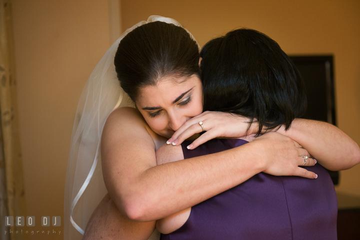 Bride hugging Mother and getting emotional. Marriott Washingtonian Center wedding at Gaithersburg Maryland, by wedding photographers of Leo Dj Photography. http://leodjphoto.com