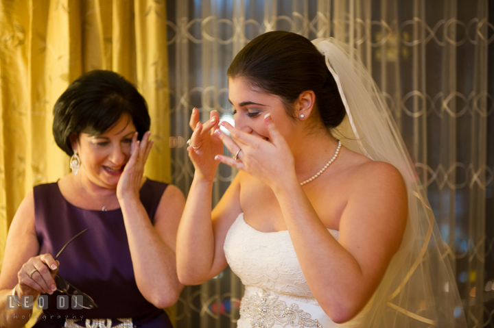 Bride and Mother wiping tears after hugging each other. Marriott Washingtonian Center wedding at Gaithersburg Maryland, by wedding photographers of Leo Dj Photography. http://leodjphoto.com
