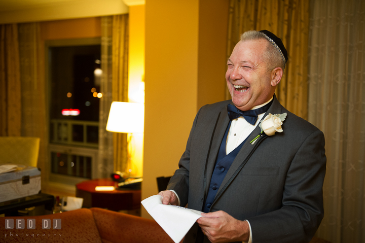 Father of the Bride laughing, happy after receiving handkerchief gift from daughter. Marriott Washingtonian Center wedding at Gaithersburg Maryland, by wedding photographers of Leo Dj Photography. http://leodjphoto.com