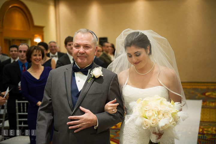 Father of the Bride escorting daughter walking down the aisle. Marriott Washingtonian Center wedding at Gaithersburg Maryland, by wedding photographers of Leo Dj Photography. http://leodjphoto.com