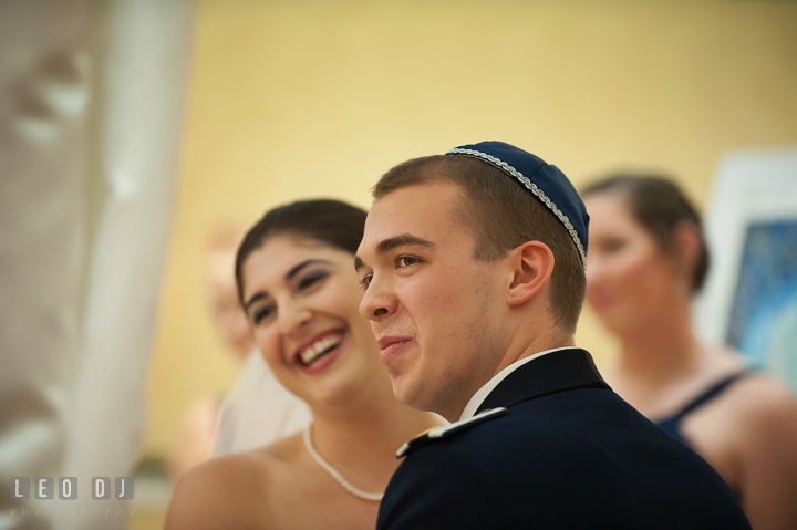 Bride and Groom laughing listening to the seven blessings. Marriott Washingtonian Center wedding at Gaithersburg Maryland, by wedding photographers of Leo Dj Photography. http://leodjphoto.com