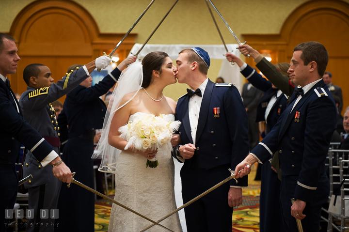 Bride and Groom kissed during the military wedding cordon after the Jewish wedding ceremony. Marriott Washingtonian Center wedding at Gaithersburg Maryland, by wedding photographers of Leo Dj Photography. http://leodjphoto.com