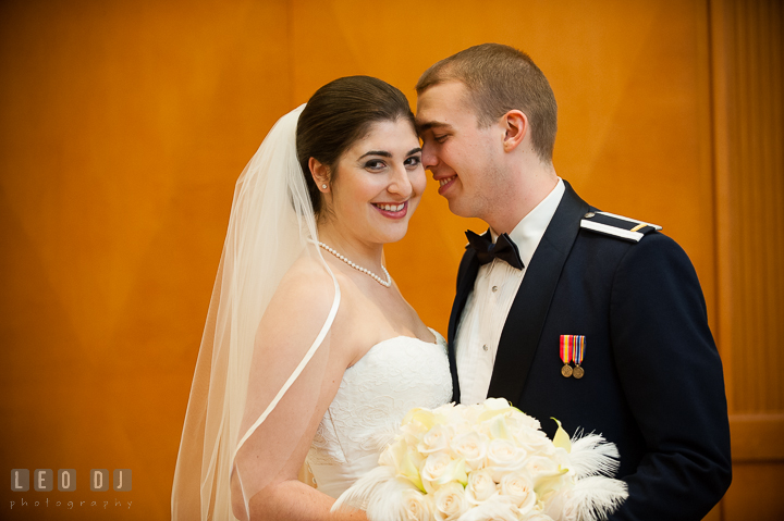 Bride and Groom smiling and cuddling. Marriott Washingtonian Center wedding at Gaithersburg Maryland, by wedding photographers of Leo Dj Photography. http://leodjphoto.com
