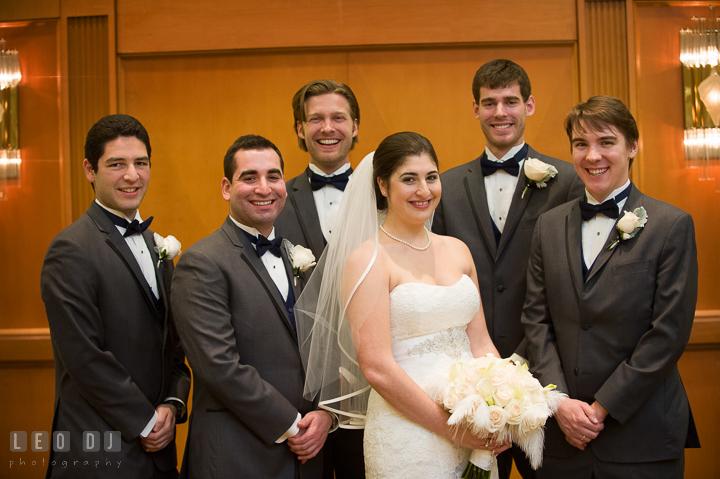 Bride posing with the Best Man and Groosmen. Marriott Washingtonian Center wedding at Gaithersburg Maryland, by wedding photographers of Leo Dj Photography. http://leodjphoto.com