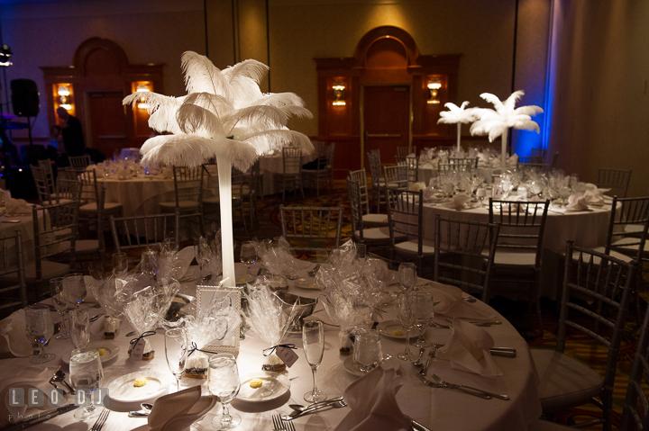 Table centerpiece decors with feather palm trees. Marriott Washingtonian Center wedding at Gaithersburg Maryland, by wedding photographers of Leo Dj Photography. http://leodjphoto.com