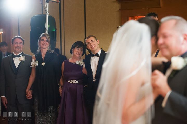 Mother of Bride and Groom smiling looking at Bride dancing with Father. Marriott Washingtonian Center wedding at Gaithersburg Maryland, by wedding photographers of Leo Dj Photography. http://leodjphoto.com