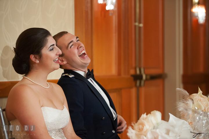 Bride and Groom laughing listening to Father or Bride toast speech. Marriott Washingtonian Center wedding at Gaithersburg Maryland, by wedding photographers of Leo Dj Photography. http://leodjphoto.com