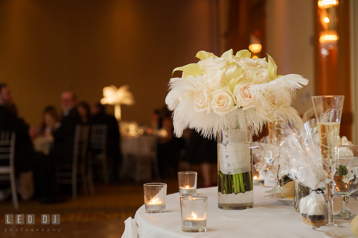 White floral wedding bouquet by Sweet Blossoms for Bride on the sweetheart table. Marriott Washingtonian Center wedding at Gaithersburg Maryland, by wedding photographers of Leo Dj Photography. http://leodjphoto.com