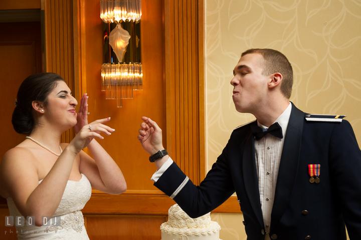 Bride and Groom feeding wedding cake to each other. Marriott Washingtonian Center wedding at Gaithersburg Maryland, by wedding photographers of Leo Dj Photography. http://leodjphoto.com