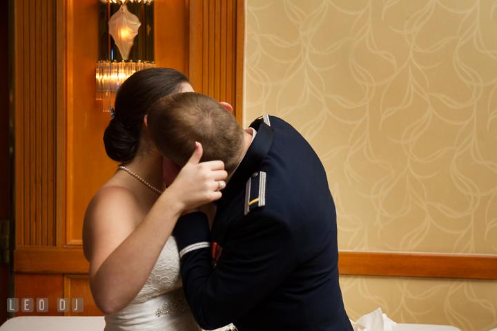 Groom kissing Bride after cake cutting. Marriott Washingtonian Center wedding at Gaithersburg Maryland, by wedding photographers of Leo Dj Photography. http://leodjphoto.com