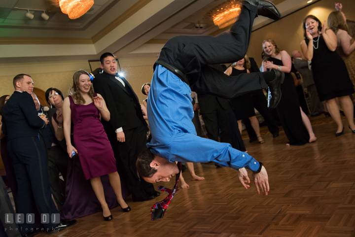 Guest flipped in the air while dancing during open dance. Marriott Washingtonian Center wedding at Gaithersburg Maryland, by wedding photographers of Leo Dj Photography. http://leodjphoto.com