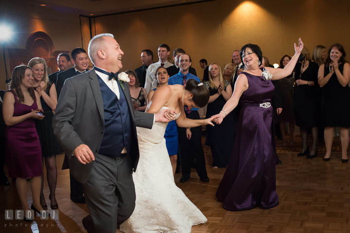 Bride dancing and laughing with her Mother and Father. Marriott Washingtonian Center wedding at Gaithersburg Maryland, by wedding photographers of Leo Dj Photography. http://leodjphoto.com