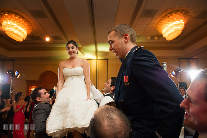 Bride and Groom lifted up on chairs during hora dance. Marriott Washingtonian Center wedding at Gaithersburg Maryland, by wedding photographers of Leo Dj Photography. http://leodjphoto.com