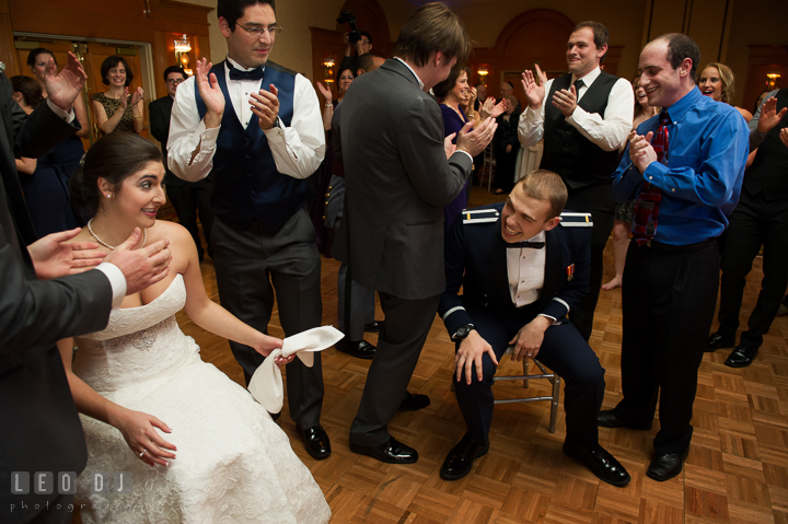 Bride and Groom laughing after lifted up on chairs during hora dance. Marriott Washingtonian Center wedding at Gaithersburg Maryland, by wedding photographers of Leo Dj Photography. http://leodjphoto.com