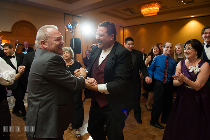 Father of Bride dancing and laughing with a guest. Marriott Washingtonian Center wedding at Gaithersburg Maryland, by wedding photographers of Leo Dj Photography. http://leodjphoto.com