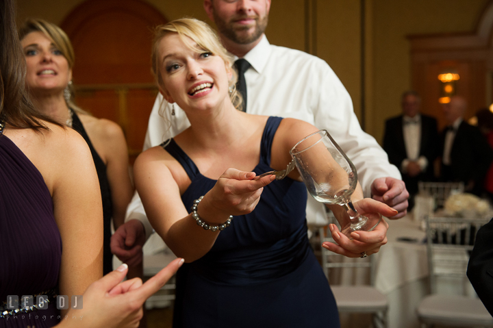 Bridesmaid clinking on glass so Bride and Groom would kiss. Marriott Washingtonian Center wedding at Gaithersburg Maryland, by wedding photographers of Leo Dj Photography. http://leodjphoto.com