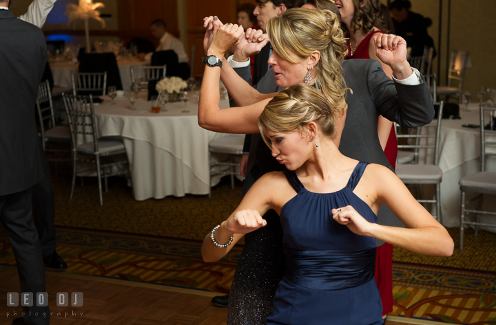 Bridesmaid dancing with mother and father. Marriott Washingtonian Center wedding at Gaithersburg Maryland, by wedding photographers of Leo Dj Photography. http://leodjphoto.com
