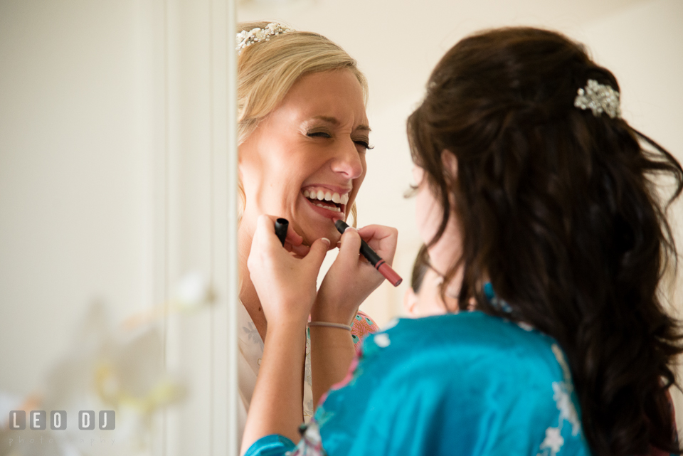The Oaks Waterfront Inn Maid of Honor put lipstick on laughing Bride photo by Leo Dj Photography