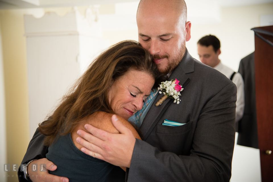 The Oaks Waterfront Inn Mother of Groom hugging son with love photo by Leo Dj Photography