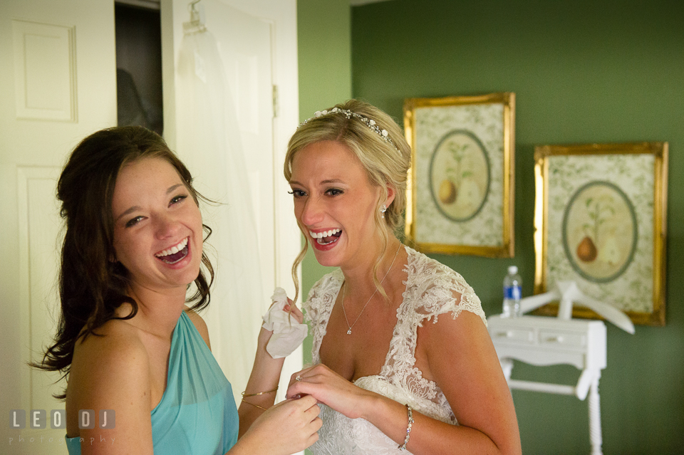 The Oaks Waterfront Inn Bride and Maid of Honor laughing together photo by Leo Dj Photography