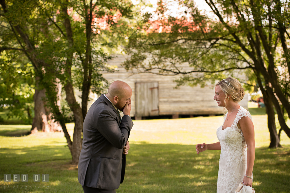 The Oaks Waterfront Inn Groom in awe seeing Bride the first time in her wedding dress photo by Leo Dj Photography