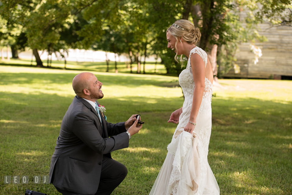 The Oaks Waterfront Inn Groom knelt in front of Bride proposing with earrings photo by Leo Dj Photography