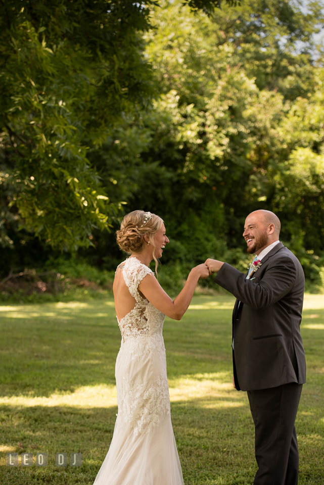 The Oaks Waterfront Inn Bride and Groom pounding fist during their first glance photo by Leo Dj Photography