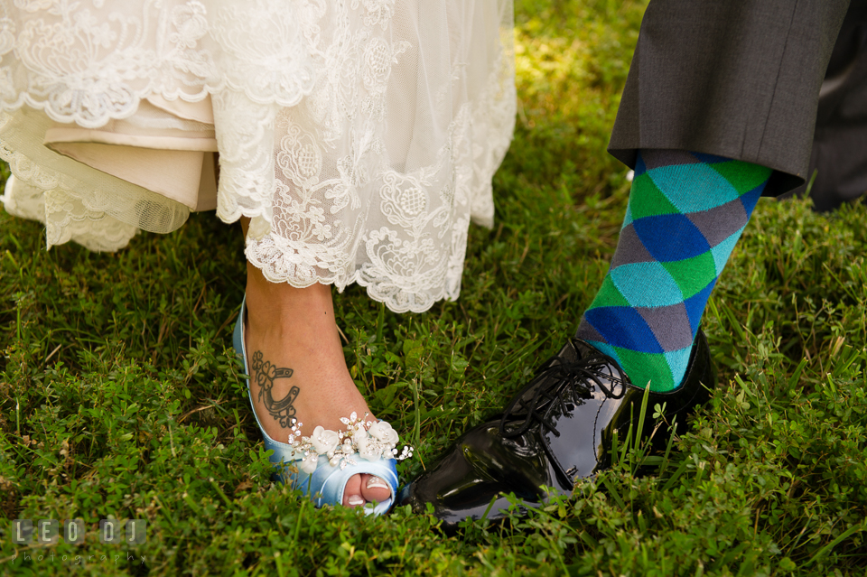 The Oaks Waterfront Inn Bride and Groom showing shoes and socks photo by Leo Dj Photography