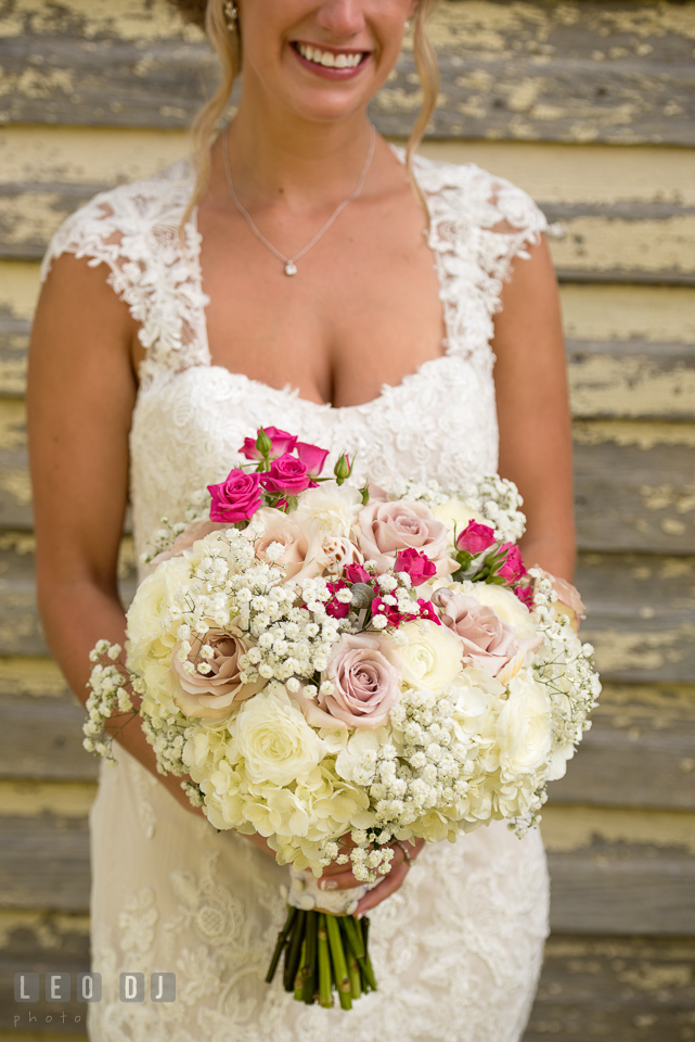 The Oaks Waterfront Inn Bride beautiful large flower bouquet by florist Seasonal Flowers photo by Leo Dj Photography