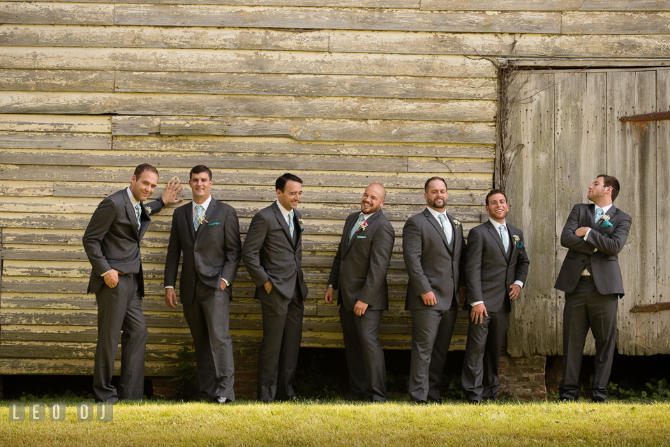 The Oaks Waterfront Inn Groom with Best Man and Groomsmen laughing while posing photo by Leo Dj Photography