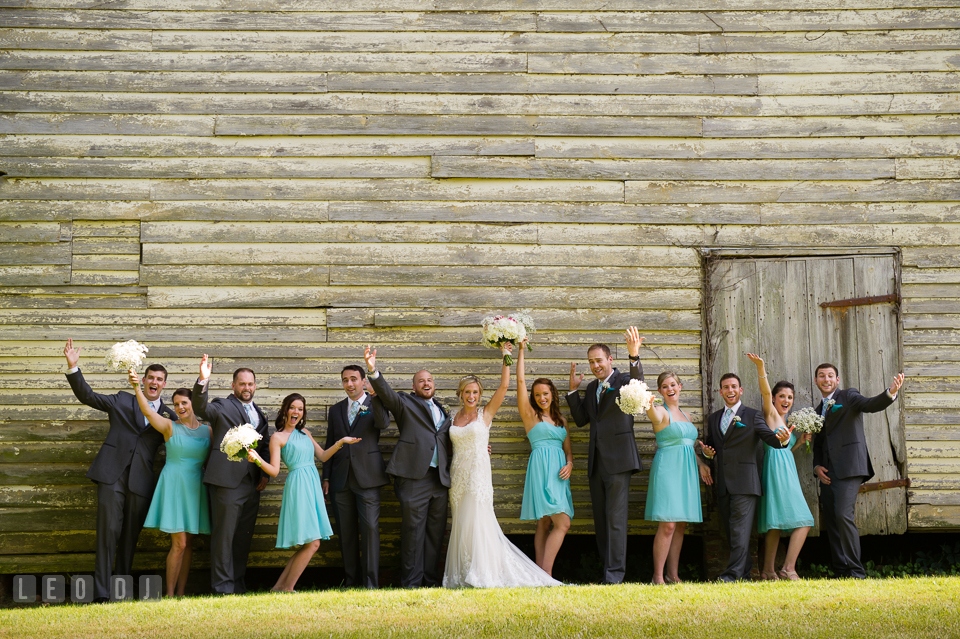 The Oaks Waterfront Inn Bride, Groom and the whole wedding party doing the happy pose photo by Leo Dj Photography