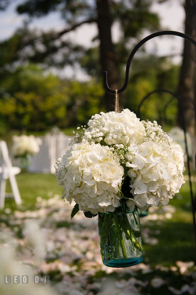 The Oaks Waterfront Inn white hydrangea floral decorations at the ceremony aisle by florist Seasonal Flowers photo by Leo Dj Photography