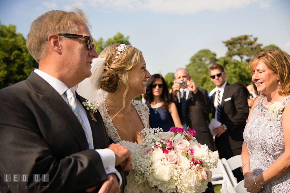 The Oaks Waterfront Inn Mother of Bride crying seeing daughter walking down the aisle during ceremony photo by Leo Dj Photography