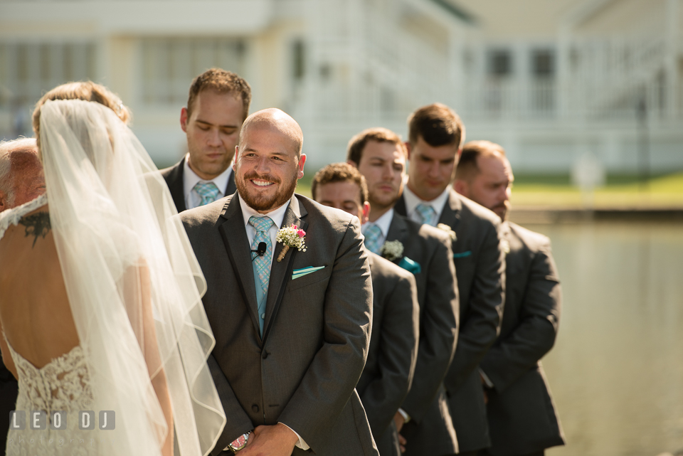 The Oaks Waterfront Inn Groom smiling seeing Bride during the ceremony photo by Leo Dj Photography